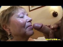 Granny wears black stockings and sucks a dudes thick man meat